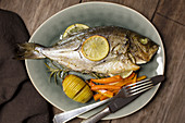 Croatian-style seabream (cooked in olive oil and white wine) with duchesse potatoes and oven-roasted carrots