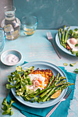 Potatoe cake with asparagus, poached egg and salad