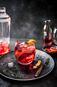 Negroni cocktail with martini, campari, vermouth and blood orange slices