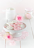 Meringue rose on a cake stand