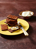 Crackers made with cocoa and smoked paprika served with cream cheese