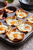 Eggs baked in toast in a muffin tin