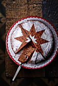 A chocolate nut cake with an icing sugar star