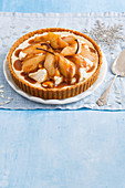 Gingernut cheesecake tart with sticky maple pears