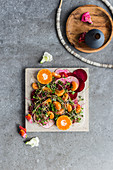 Crudo salad with beetroot and baby clementines