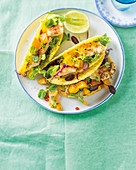 Coconut-crusted fish tacos with mango salsa