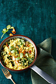Crispy garlic-topped cumin and spinach pilaf