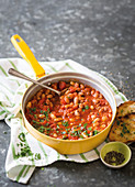Tuscan tomato-bean bake with herb bruschetta