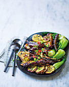 Sticky Asian lamb ribs with sweet potato rounds