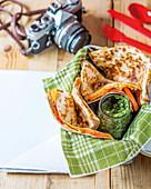 Quesadillas with ham, pesto, tomato and cheese