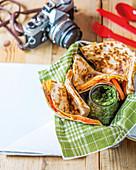 Quesadillas with ham, pesto, tomato and cheese