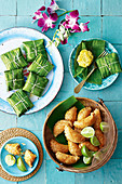 Beef curry puffs and Spicy fish cakes in banana leaves