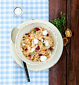 Wheat risotto with feta cheese, thyme and walnuts