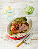Roast lamb with peeled potatoes and cucumber salad