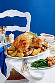 Roast turkey with bacon and herb stuffing