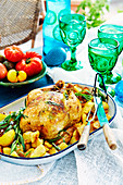 Herb-stuffed chicken with crushed potatoes