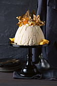 An ice cream bomb with white chocolate, mango and macadamia brittle