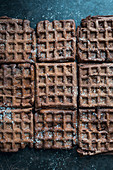 Chocolate waffles dusted with icing sugar (vegan)