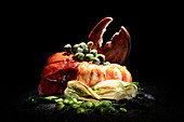 Lobster with stuffed zucchini blossoms