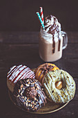 Different variations of the sweet donuts and cream coffee, selective focus