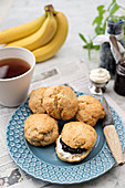 Banana scones with blueberry jam and cream for teatime