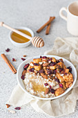 Porridge with caramelised apples, almonds, cranberries, cinnamon and honey
