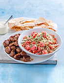Beef meatballs with watermelon tabouli
