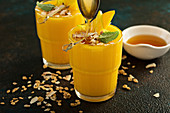 Mango smoothies with honey and coconut
