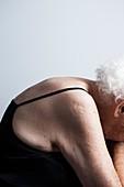Elderly woman with bent posture