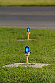 Blue airport taxiway lights