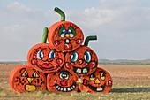 Hay bales decorated for Halloween, Texas, USA