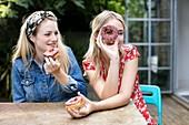 Women with doughnuts