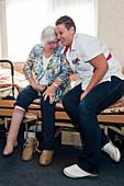 Nurse hugging an elderly woman