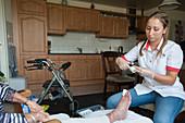 Nurse dressing a foot wound