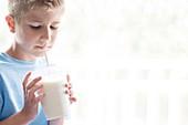 Boy drinking milk through a straw