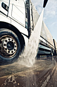 Washing commercial truck with jet sprayer