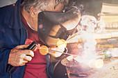 Welder in workshop