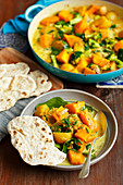 Vegetarian curry with potatoes, pumpkin, broccoli, spinach
