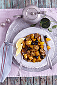 Oriental lamb tagine with potatoes and black olives