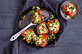 Oriental, stuffed peppers with couscous and feta cheese