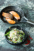 Crispy salmon with edamame and rice noodle salad