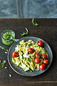 Lupine noodles with pesto and braised tomatoes