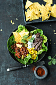 Nacho bowls with smoked BBQ azuki beans and beef steak