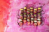 Fruit kebabs with chocolate sauce and coconut cream