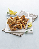 Breaded rabbit pieces with sage and lemon (Italy)