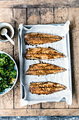 Oven-baked mackerel with kale salad