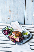 Portobello duck burger with red cabbage salad