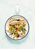Vegetables with sesame and semolina dumplings