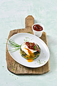 Potato and kale patties with a poached egg and barbecue sauce