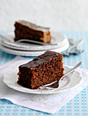 Two slices of ginger cake with a chocolate glaze